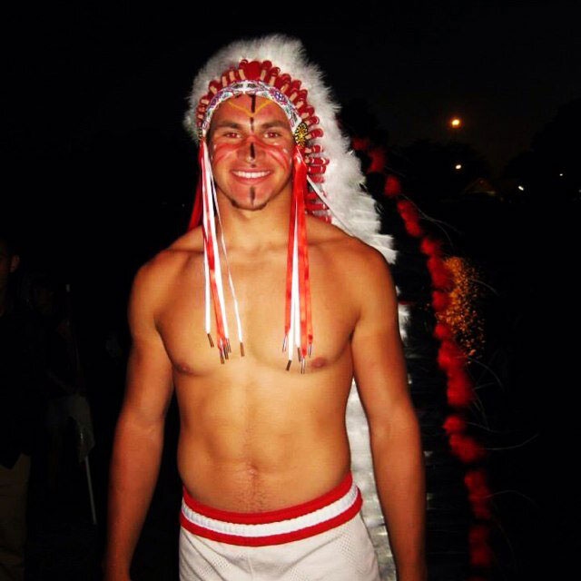 Senior+Sean+Bernard+led+the+football+team+at+the+bonfire%2C+wearing+the+traditional+headdress.