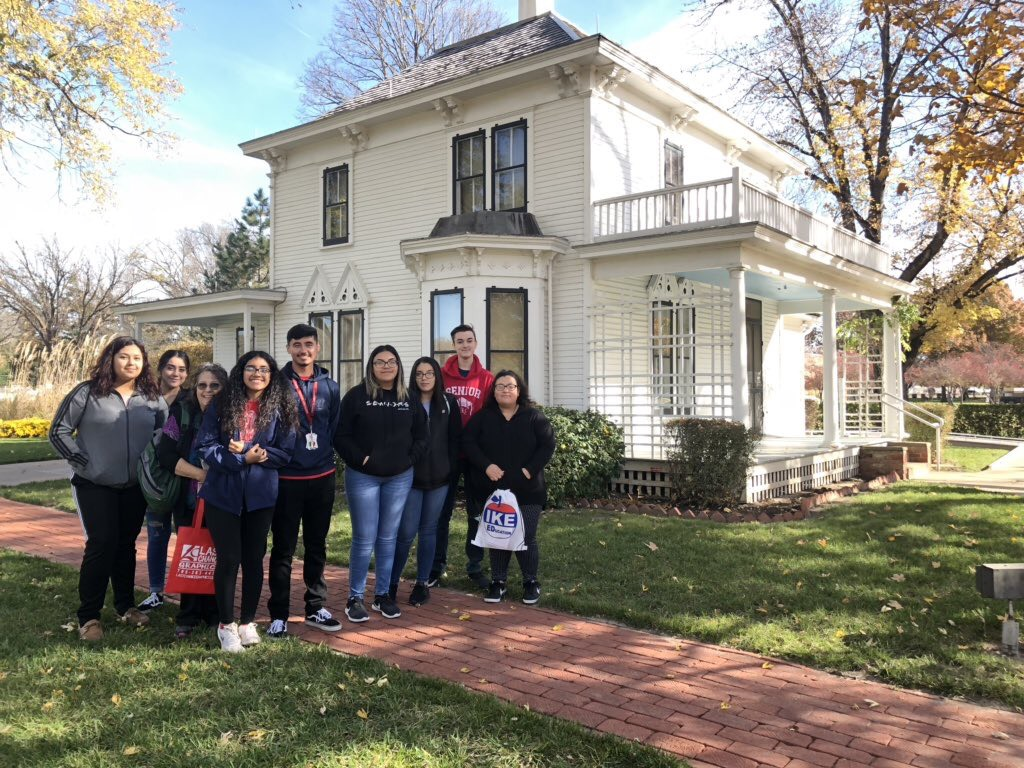 History Club poses next to former President Eisenhower's childhood home while visiting the Eisenhower Presidential Library Museum in Abilene, Kansas.