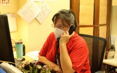 School Nurse Carmina Suter answers another phone call during her busy school day.